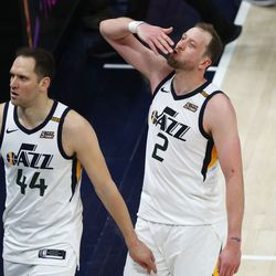 Utah Jazz guard Joe Ingles (2) blows a kiss to his family in the stands as he and Utah Jazz forward Bojan Bogdanovic (44) walk off the court after a game with the Indiana Pacers at the Vivint Arena in Salt Lake City on Friday, April 16, 2021. The Jazz won 119-111.