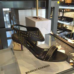 Black studded sandals, $247.50 (originally $825)