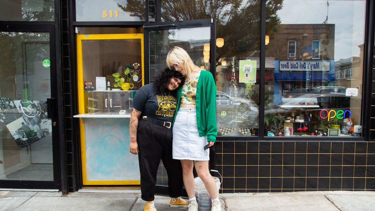Mina's World co-owners Sonam Parikh and Kate Egghart in front of their West Philly coffee shop