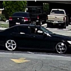A black Lexus sedan is pictured leaving the site of a fatal auto-pedestrian crash on Wednesday, June 7, 2017. Police are seeking the driver, who they say caused the crash intentionally and fled the scene.
