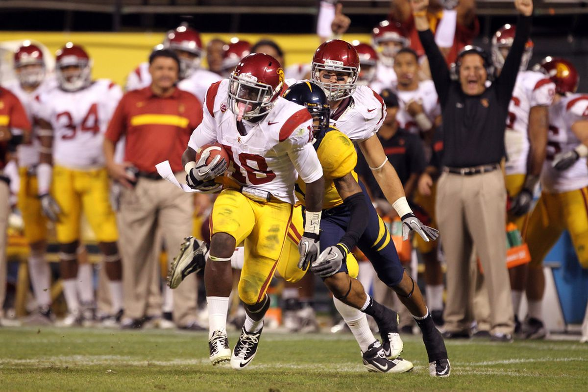 SAN FRANCISCO, CA - OCTOBER 13:  Dion Bailey #18 of the USC Trojans intercepts a pass intended for Marvin Jones #1 of the California Golden Bears at AT&T Park on October 13, 2011 in San Francisco, California.  (Photo by Ezra Shaw/Getty Images)