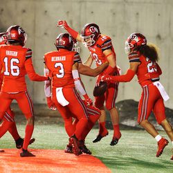 Utah Utes wide receiver Britain Covey (18) celebrates a kick return for touchdown with teammates as Utah and Oregon State play a college football game at Rice Eccles stadium in Salt Lake City on Sunday, Dec. 6, 2020. Utah won 30-24.