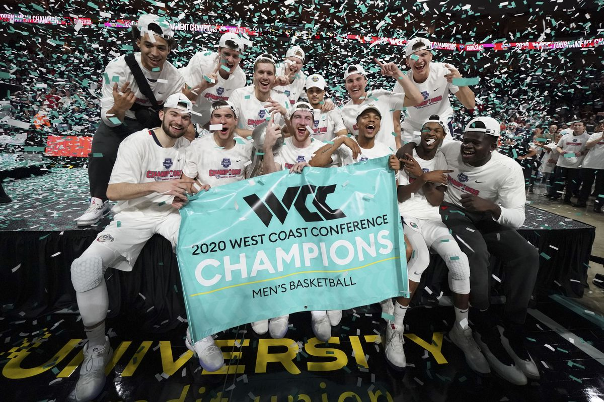 Gonzaga Bulldogs celebrate after hoisting the trophy against the Saint Mary's Gaels after the championship game in the WCC Basketball Tournament at Orleans Arena.