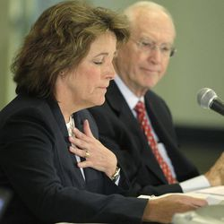 Cindy Hoye, executive director of the Indiana State Fair Commission, makes a statement as Chairman Andre Lacy listens during a Indiana State Fair Commission meeting Thursday, April 12, 2012, in Indianapolis. The commission released findings from two investigations into last August's deadly stage collapse.