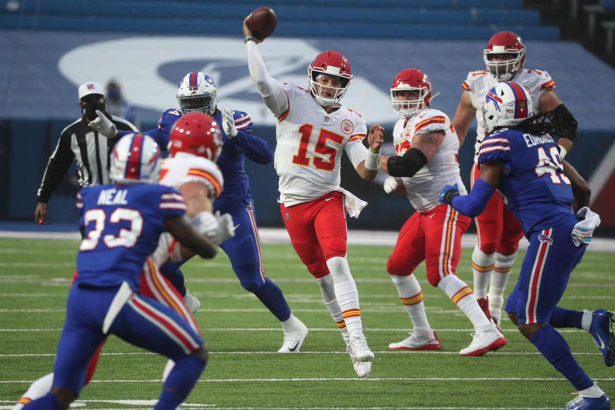 Chief's quarterback Patrick Mahomes is pressured but still makes an off-balance throw in a 26-17 win over the Bills.