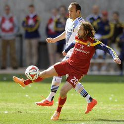 Real Salt Lake midfielder Ned Grabavoy (20) boots the ball in front of a Los Angeles Galaxy defender during a game at Rio Tinto Stadium on Saturday, March 22, 2014.