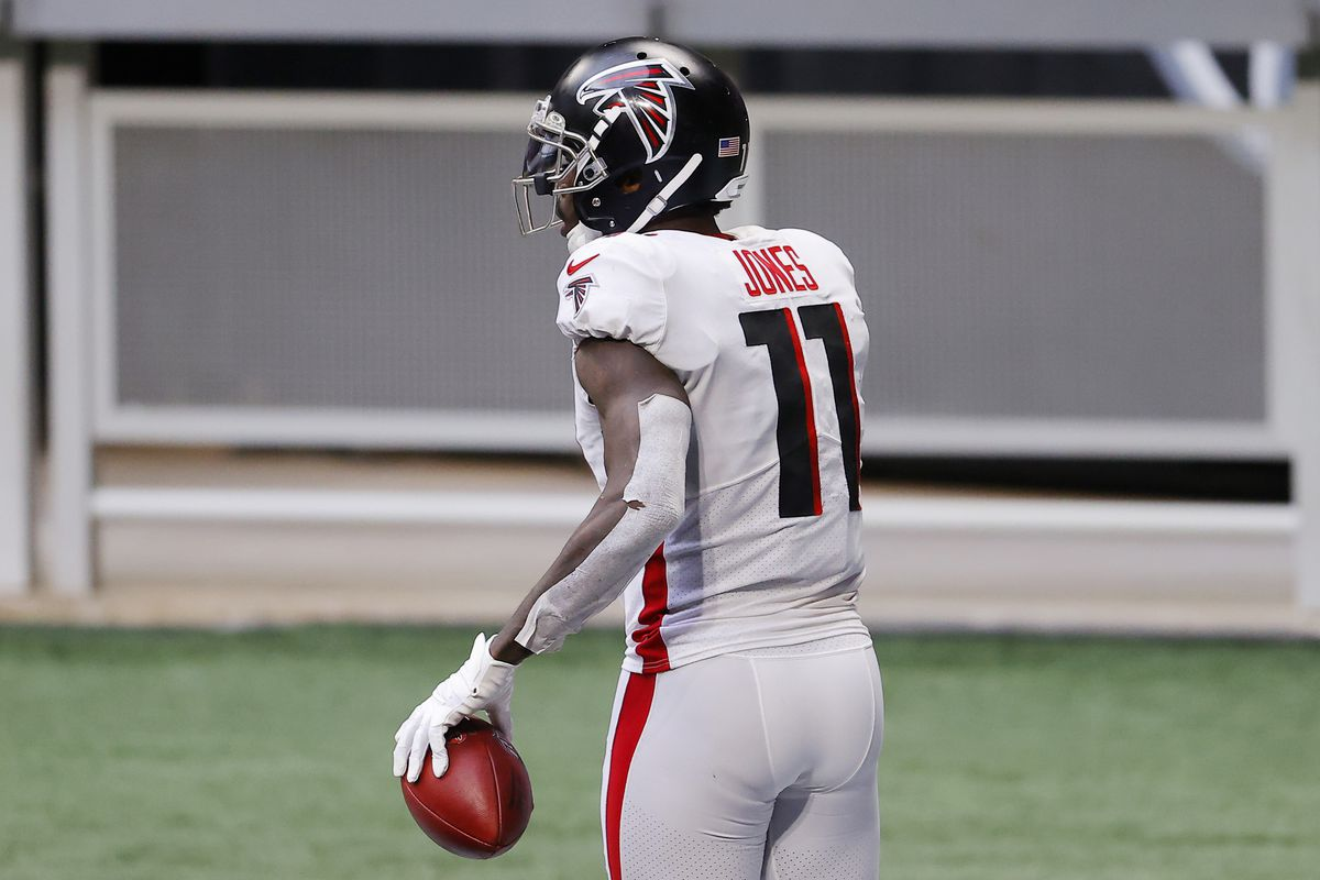Julio Jones #11 of the Atlanta Falcons reacts after scoring a touchdown during the third quarter against the Denver Broncos at Mercedes-Benz Stadium on November 08, 2020 in Atlanta, Georgia.