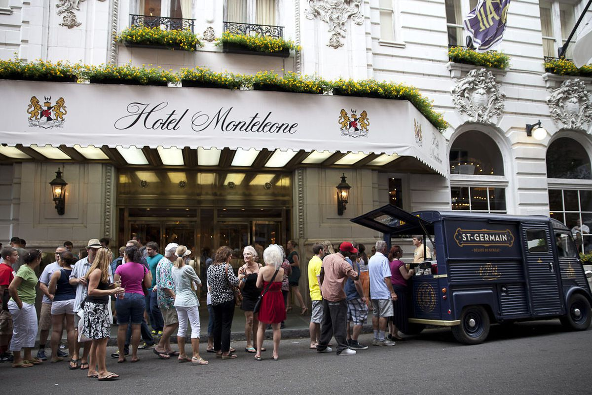 Tales goers hang outside the Hotel Monteleone, where many of the events are sponsored, and receive drinks crafted by St. Germain.