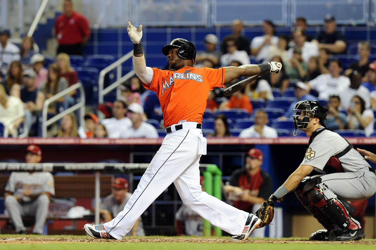 April 15, 2012; Miami, FL, USA; Miami Marlins third baseman Hanley Ramirez (2) connects after hitting a two run homer in the eighth inning against the Houston Astros at Marlins Park. Mandatory Credit: Steve Mitchell-US PRESSWIRE