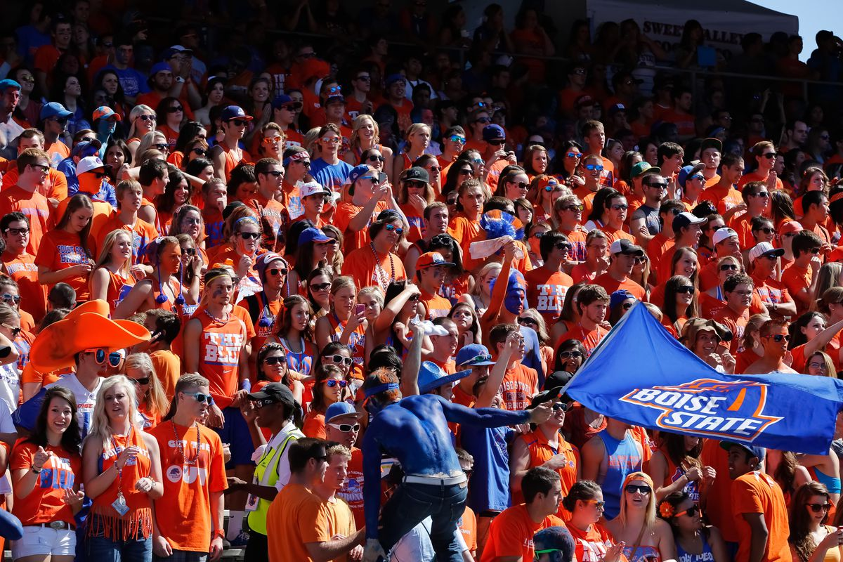 BOISE, ID - SEPTEMBER 15:  The Boise State student section cheers before the game between the Miami University RedHawks and the Boise State Broncos at Bronco Stadium on September 15, 2012 in Boise, Idaho.  (Photo by Otto Kitsinger III/Getty Images)