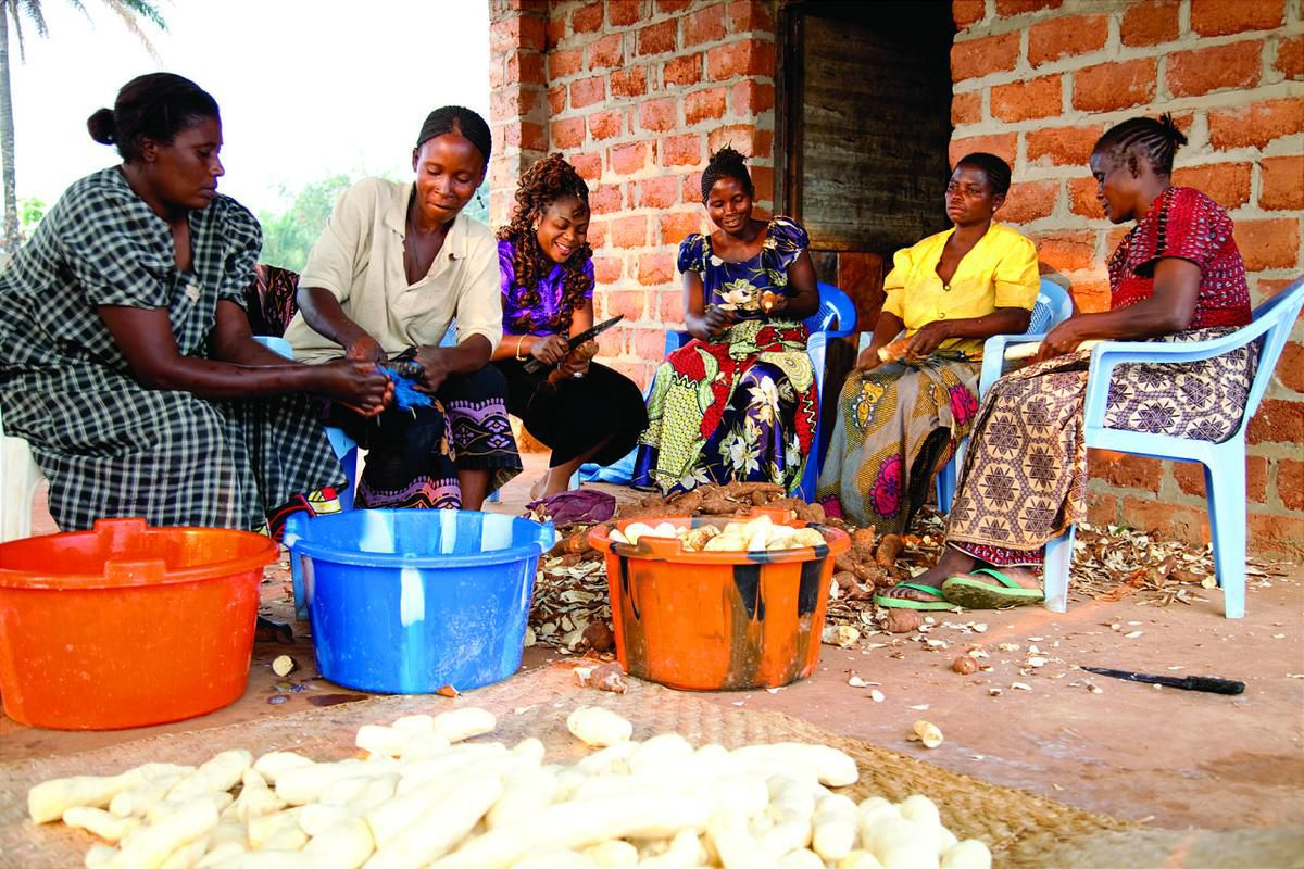LDS Relief Society members in DR Congo prepare food for the church to distribute through its humanitarian efforts to fight hunger in Africa.