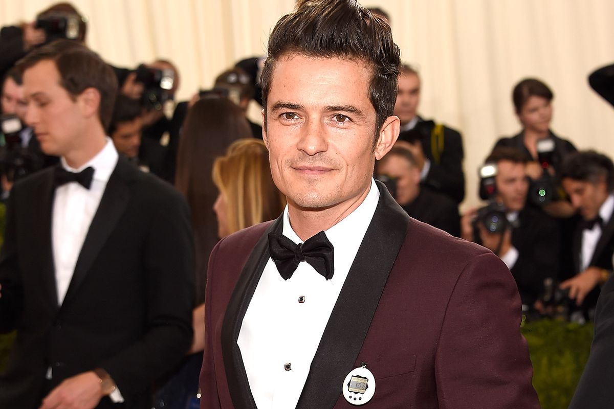 Orlando Bloom with '90s relic. Photo: Kevin Mazur/Getty Images