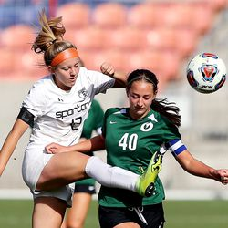 Murray's Aly Starbuck kicks the ball away from Olympus' Fifi Ward during 5A state semifinal action at Rio Tinto Stadium in Sandy on Tuesday, Oct. 20, 2020. Olympus won 2-1 to advance to the championship game.
