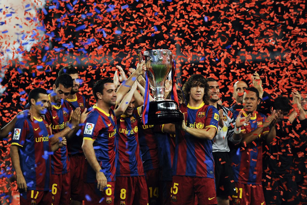 Barcelona's holding the 2010-11 Liga trophy, the last time they lifted the cup.
