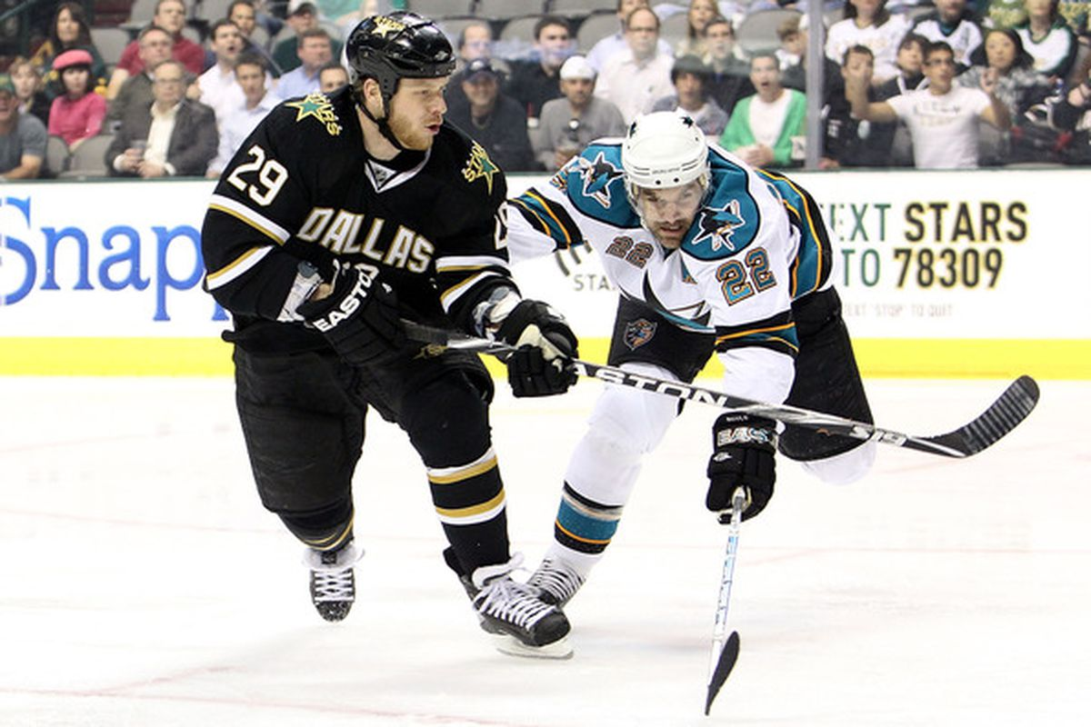 DALLAS - MARCH 31:  Steve Ott #29 of the Dallas Stars shoots defended by Dan Boyle #22 of the San Jose Sharks at American Airlines Center on March 31, 2010 in Dallas, Texas.  (Photo by Ronald Martinez/Getty Images)