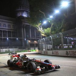 McLaren Formula One driver Jenson Button of Britain steers his car during the Singapore Formula One Grand Prix on the Marina Bay City Circuit in Singapore, Sunday Sept. 23, 2012.