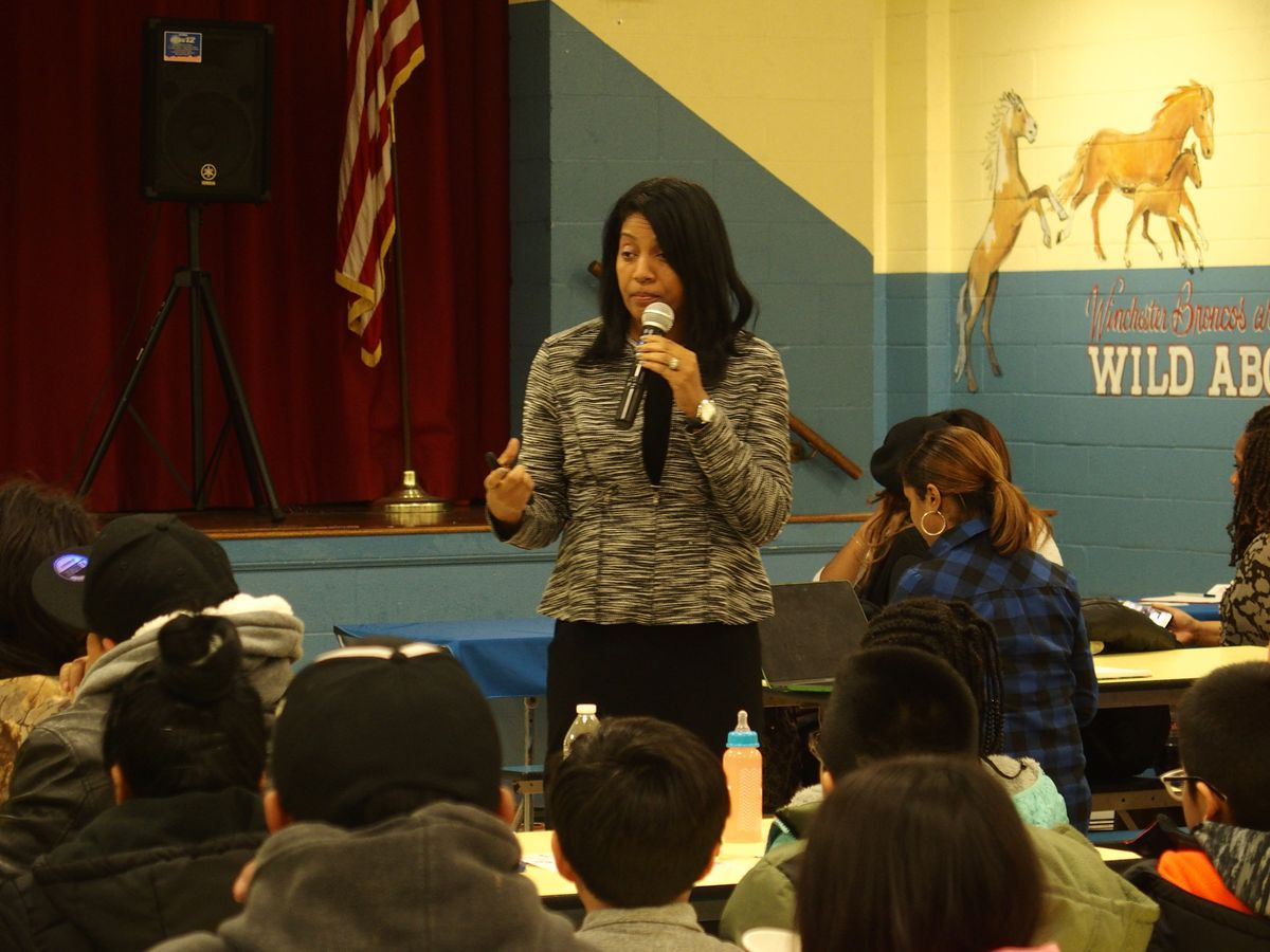 Angela Whitelaw, the district's deputy superintendent of schools and academic support, explains the partnership with Memphis Teacher Residency to Winchester Elementary parents and teachers during a community meeting in January. The partnership was canceled before it could begin amid community backlash.