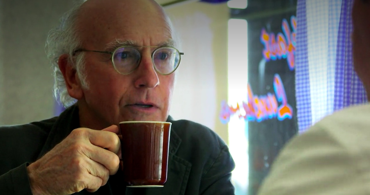 Larry David drinking a cup of tea