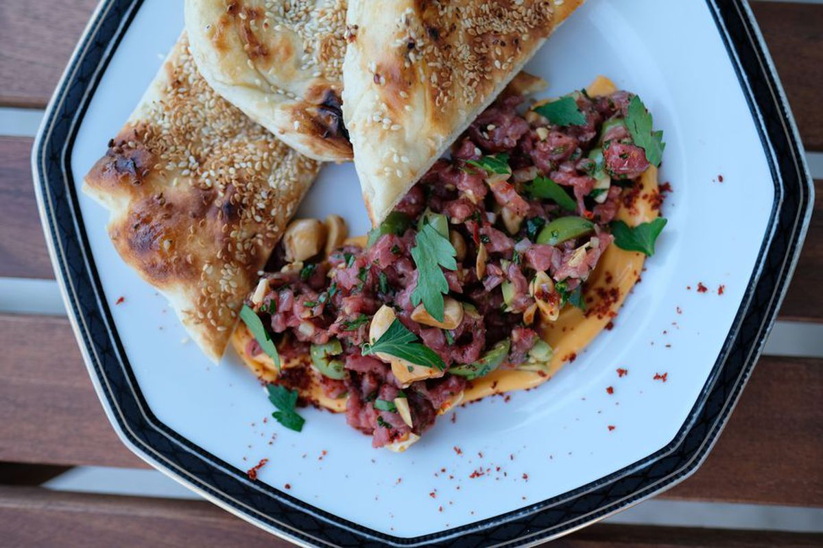 a plate of naan and lamb tartare