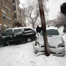 Two cars collided during the treacherous drive in the Avenues following an ice storm in Salt Lake City on Thursday, Dec. 19, 2013.