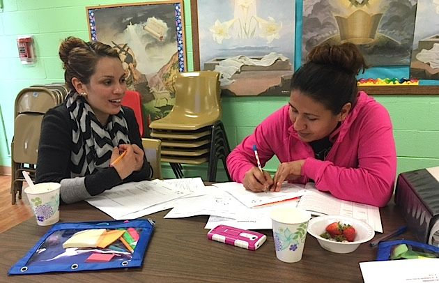 Two PASO participants work on an activity together at a recent class in Longmont.