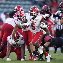 Utah running back TJ Pledger (5) is tripped up by San Diego State linebacker Michael Shawcroft (46) during the first half of an NCAA college football game Saturday, Sept. 18, 2021, in Carson, Calif.