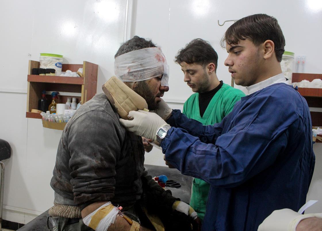 Doctors treat an injured Syrian man