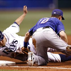 Texas Rangers third baseman Michael Young, right, tags out Tampa Bay Rays' Dioner Navarro on a steal attempt.