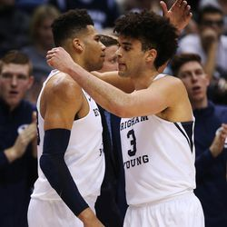 Brigham Young Cougars forward Yoeli Childs (23) and Brigham Young Cougars guard Elijah Bryant (3) leave the game in Provo on Thursday, Dec. 28, 2017. BYU won 69-45.