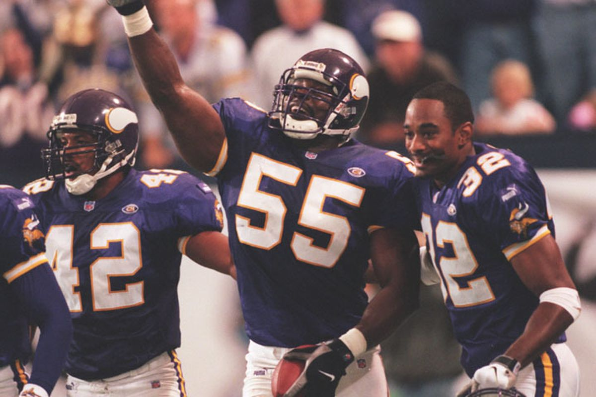 Minneapolis, MN 10/3/99 Vikings vs. Tampa Bay Buccaneers -- Linebacker Corey miller celebrates after intercepting a Tampa Bay pass with minutes to go in the fourth quarter, preventing them from scoring to tie the game. The Vikings won. 21-14.