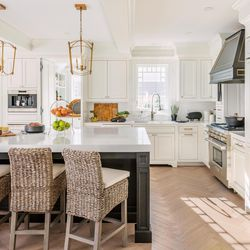 """""""Small but mighty"""" is how homeowner Kassiane Campopiano describes her new kitchen. At right is a pro-style range. At the rear, a window over the sink looks out onto the backyard."""