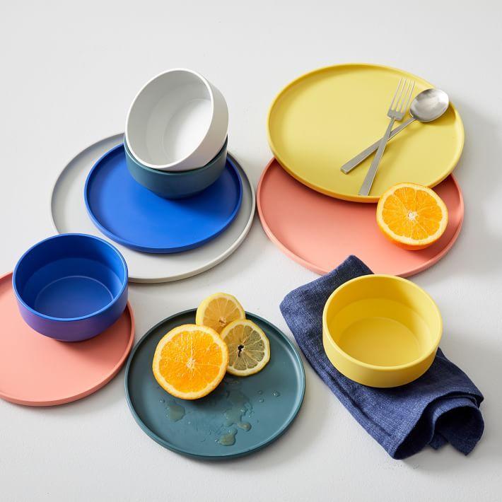 A set of West Elm dinnerware in various colors
