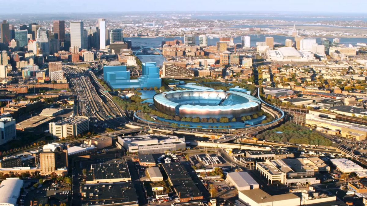 Aerial rendering of a stadium in a city.