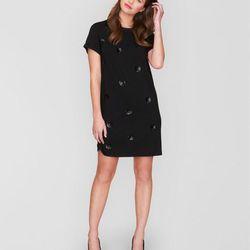 "<a href=""http://www.jaeger.co.uk/Polka%20Dot%20Sequin%20Jersey%20Dress/630043G,en_GB,pd.html?dwvar_630043G_color=00100&dwvar_630043G_size=XS&start=20&cgid=women-dresses&pmin=0&pmax=100"">Polka dot dress,</a> $115  <br></br> <b>Jaeger:</b> A London classi"
