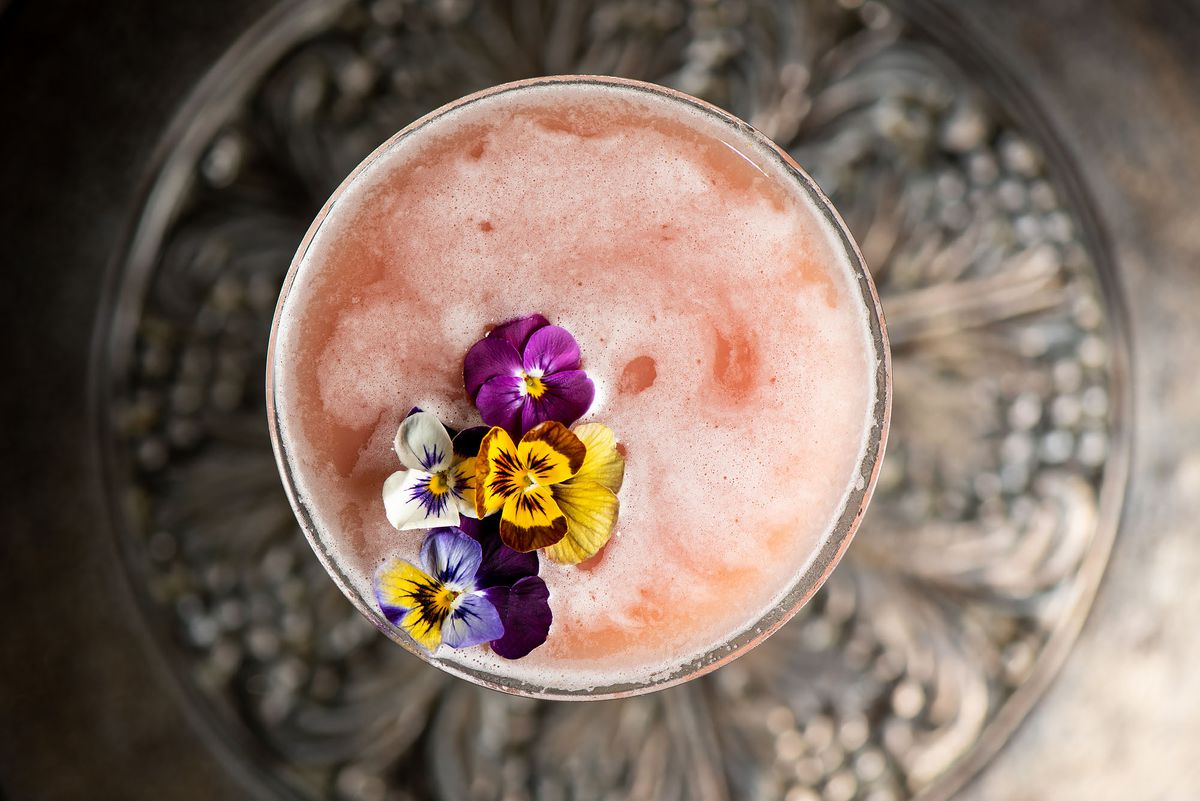 A cocktail decorated with fresh flowers.