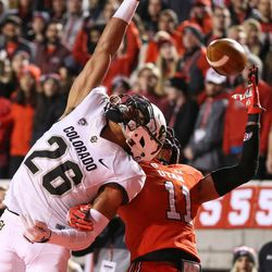 Colorado Buffaloes defensive back Isaiah Oliver (26) breaks up a pass intended for Utah Utes wide receiver Raelon Singleton (11) at Rice-Eccles Stadium in Salt Lake City on Saturday, Nov. 25, 2017.
