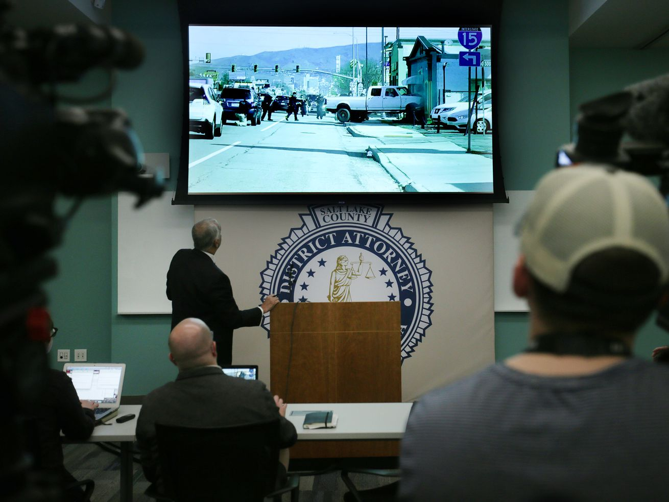 Salt Lake County District Attorney Sim Gill discusses video footage from an officer-involved shooting during a press conference at the Salt Lake County District Attorney's Office in Salt Lake City on Friday, Feb. 14, 2020. The April shooting left Harold Vincent Robinson dead following a dramatic high-speed chase that ended when Robinson crashed into he front of a store on State Street. Gill found the 10 Salt Lake police officers, three Utah Highway Patrol troopers and two Unified police officers were justified in the use of deadly force.