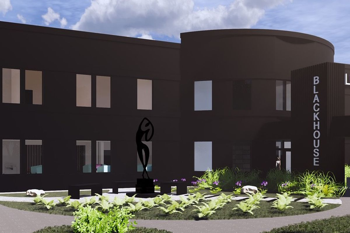 Rendering of two-story black building with windows.