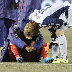 Sporting KC's Seth Sinovic talks to Real's Joao Plata as Real Salt Lake loses to Sporting KC Saturday, Dec. 7, 2013 in MLS Cup action.