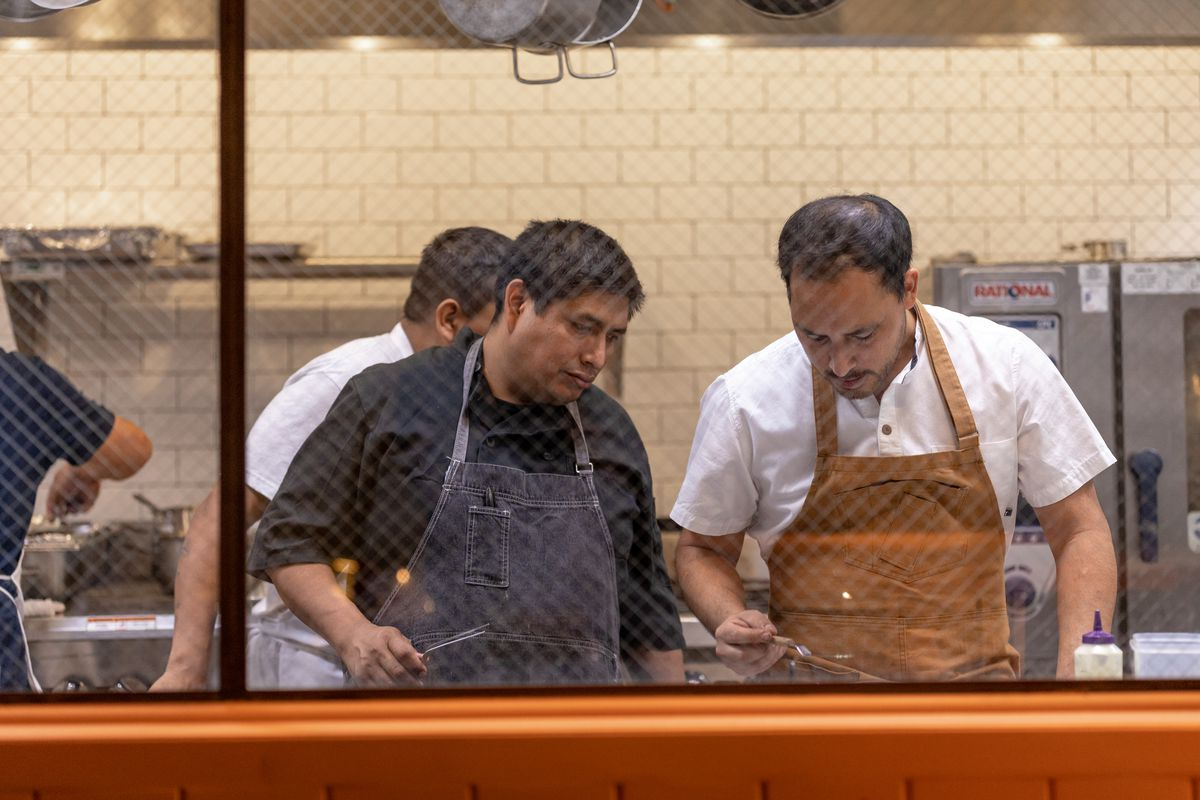 Chef Richie Lopez (left) with line cooks at Yapa in Little Tokyo.
