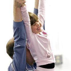 Tim Herron lifts his daughter Katie Herron, 6, during rehearsal for the Father's Day Salute at Jo Emery Dance Studio, Saturday June 6, 2009. (Janet Jensen/The News Tribune/MCT)