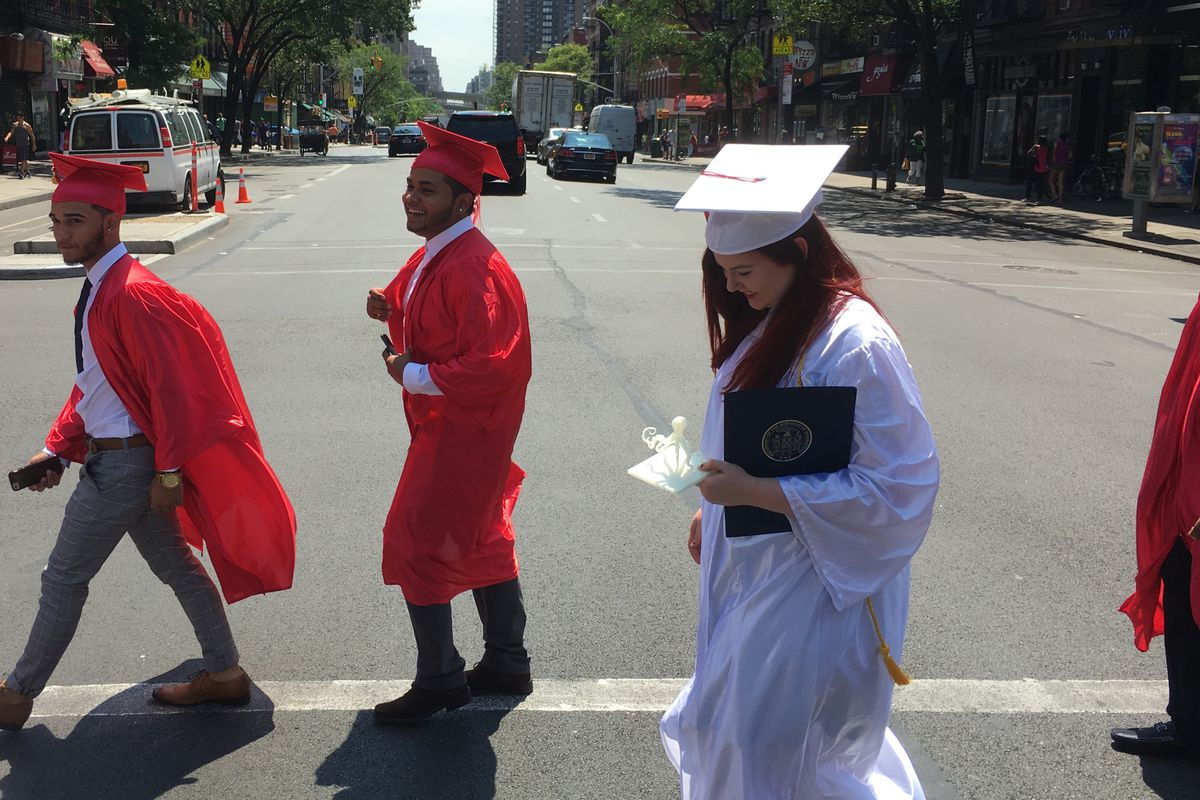 Leigh Duignan walks to graduation with classmates from The Urban Assembly Gateway School for Technology.