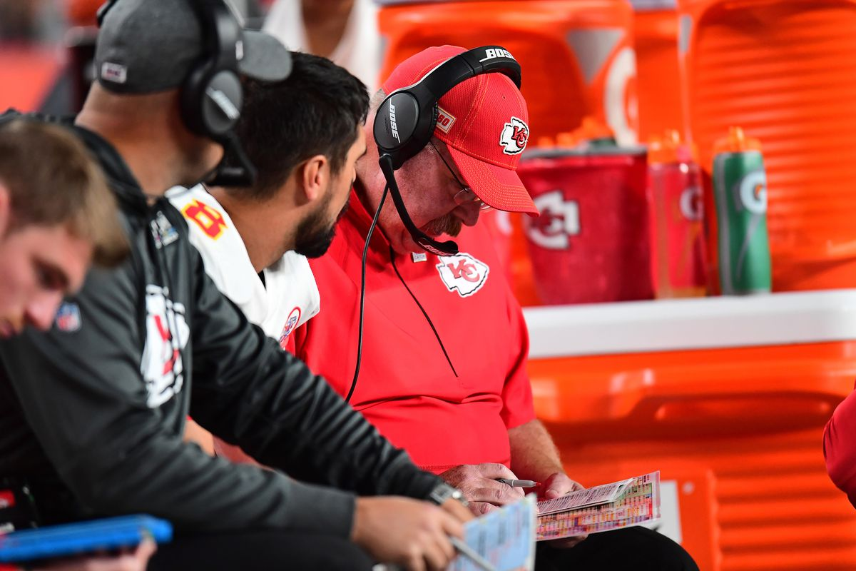 Kansas City Chiefs head coach Andy Reid sits on the bench with quarterback Matt Moore in the third quarter against the Denver Broncos at Empower Field at Mile High.