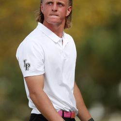 Lone Peak's Preston Smithson continues his glare after a tee shot during the 6A boys state tournament at Davis Park Golf Course in Kaysville on Tuesday, Oct. 5, 2021. Smithson tied for fourth with Ryker Lind of Herriman.