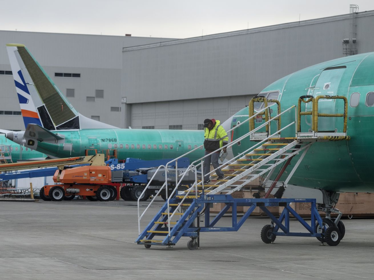 An employee walks down a stairway leading to a Boeing 737 MAX airplane on March 14, 2019, in Renton, Washington.