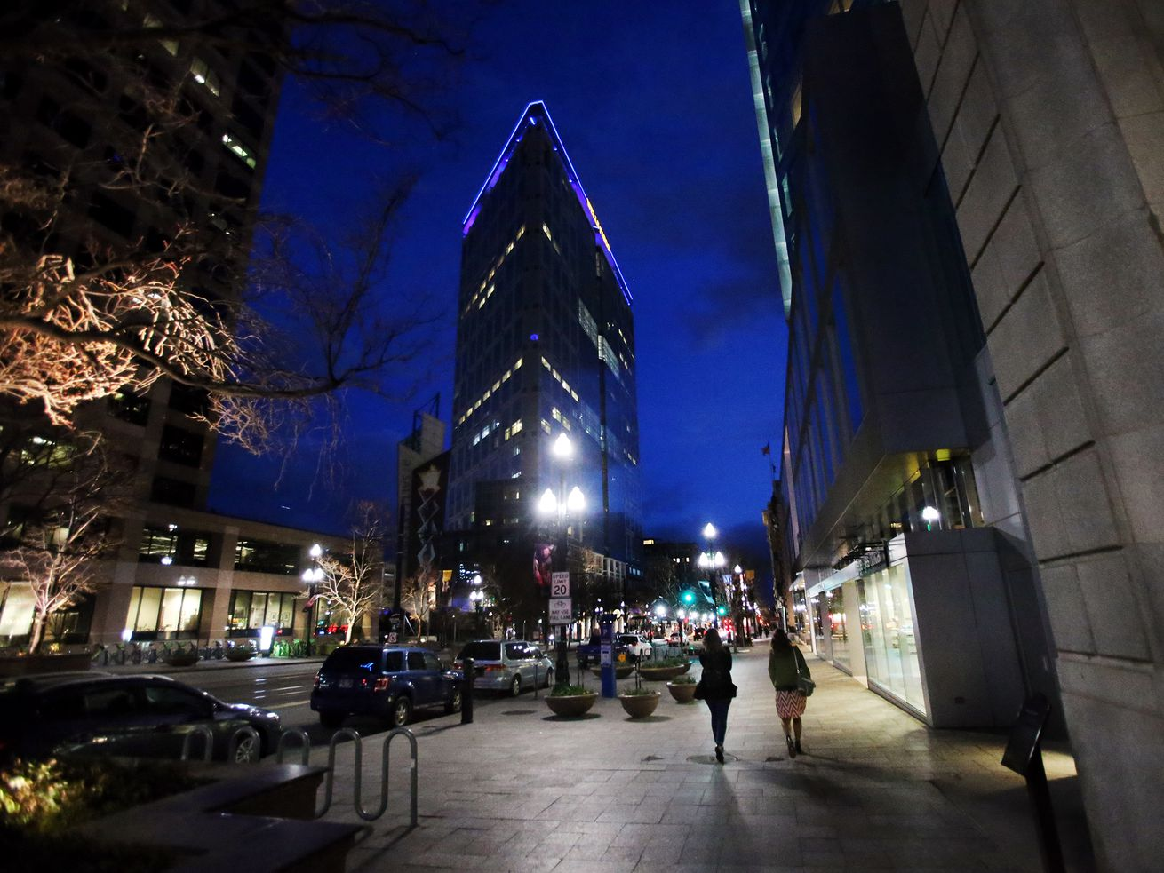 A few people are spotted on what would normally be more crowded downtown Salt Lake street on Saturday, March 14, 2020. Coronavirus concerns are keeping more people home.