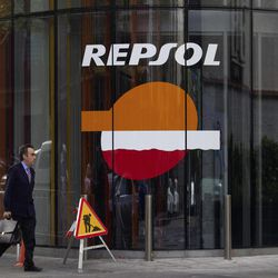 A man walks past a Repsol gas station in Madrid, Wednesday April 18, 2012. Argentina's takeover of its top energy company from Spain's Repsol might solve the country's short-term energy needs, and it thrills Argentines who blame privatizations for their economy's collapse a decade ago. But analysts say it sends a terrible signal to anyone wanting to invest in Argentina. President Cristina Fernandez made Spain furious by decreeing that her government will recover YPF by expropriating Repsol's majority stake in the company.