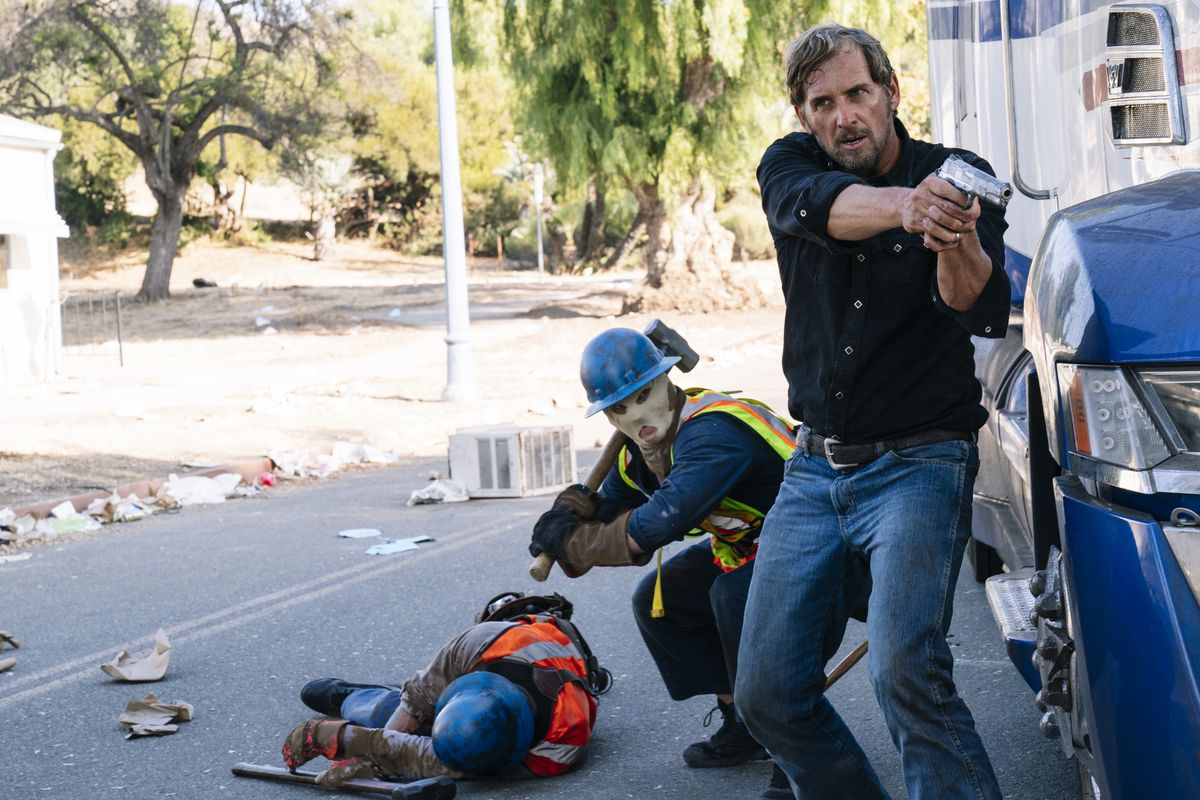 """Dylan Tucker (Josh Lucas, right) with Purgers in a scene from """"The Forever Purge,"""" directed by Everardo Valerio Gout."""