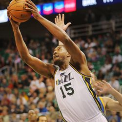 Utah's Derrick Favors gets to the hoop around Warriors' David Lee as the Utah Jazz and the Golden State Warriors play Tuesday, Oct. 8, 2013 in preseason action at Energy Solutions arena in Salt Lake City.
