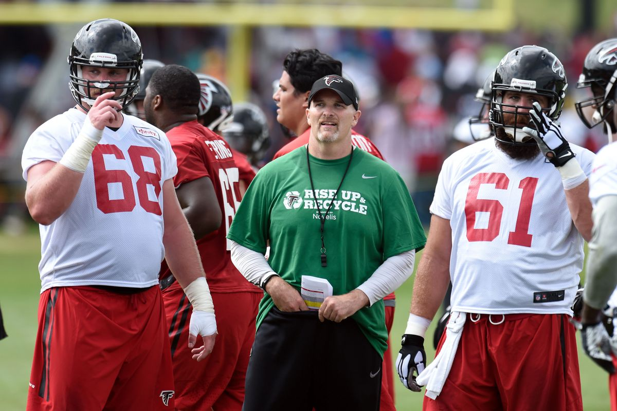 Head coach Dan Quinn, flanked by surprise starter Mike Person and surprise casualty Joe Hawley